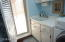 Utility sink next to washer and dryer. Window to let in natural lightl