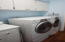 Washer and Dryer convey. Nice storage cabinets.