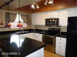Granite counters white cabinets