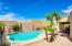 The backyard with a pristine pool, huge covered patio, grassy area, and mountain views are an oasis of fun and relaxation!