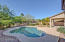 Backyard boasts gorgeous pool.