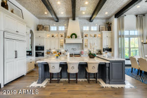 Kitchen features double oven by Wolf, a built in coffee/espresso maker, Sub Zero fridge, two dishwashers, marble counter tops, and custom tile.
