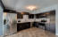 Updated kitchen features stainless steel appliances. Plenty of room to add a kitchen island!
