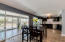 Open kitchen/dining area with back bonus room.