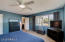 Master bedroom features large window to the backyard and en suite master bathroom.