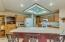 Kitchen features corian counters with counter seating.