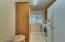Laundry room has additional cabinet storage and plenty of room to move around. Front load washer and dryer and fridge are added bonuses that stay with the house!