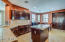 Plenty of cabinets and counter space in this beautiful kitchen with island and stainless steel appliances.