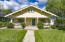 Beautiful yellow Craftsman with large gathering porch, perfect for enjoying the cool weather.
