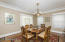 Large, open Dining room is perfect for hosting a large family meal.