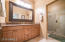 large bath with dual sinks and walk in shower