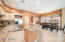 kitchen has large island, stainless steel appliances, gas cook top and pantry
