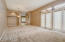 Large living room / dining room with doors out to front courtyard.