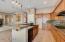 kitchen overlooks family room