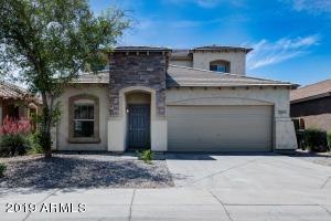Ready for immediate move in. Beautiful 5 Bedroom home with master downstairs and 4 Bedrooms Upstairs! South facing back yard that backs to common area. Open floor plan which includes a kitchen island.Refrigerator, microwave, oven, dishwasher, and washer and dryer included! This home is conveniently located minutes from Laveen Village which includes shopping, groceries, fitness and Home Depot!! Upgraded stone elevation, Bay Window in the Master Bedroom and 3 Walk in Closets!Security System Installed.