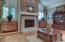 View of marble fireplace in Formal Sunken Living Room