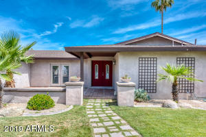This beautiful, move-in ready home offers open living spaces and mountain views in a quiet neighborhood tucked away near Papago Park. With a spacious guest casita in the backyard, complete with a full kitchen, this Heritage East home grants you the unique opportunity to allow privacy to your live-in guests or generate some extra income through AirBnb and other short-term rental options. Inside the main house and attached casita, you'll find quality finishes like travertine tile, granite countertops, and shaker cabinetry. Enjoy views of Camelback mountain from the sparkling pool, covered patio, or kitchen window. Call today to schedule your private viewing!
