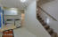 Upon Entry a work area, laundry room, bathroom behind laundry area and stairs to Guest Loft.