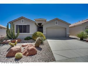 You will love this house! Located in the guard-gated 55+ community of Arizona Traditions, this is the very popular Saguaro model with a HEATED pool!!