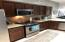 Stainless steel appliances- dark cherry wood cabinetry