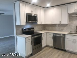 Soft close drawers/doors, crown molding, lazy susan, stainless sink, LED lighting, quartz counters, stainless appliances,