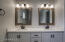 The gorgeous remodeled master bathroom is absolutely huge for this size home and features custom cabinets with double sinks