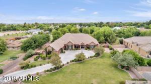 Custom home on a 59,546 sq ft gated property on a county island.