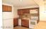 Spacious kitchen with pantry, electric range, microwave and dishwasher
