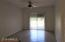 Spacious living room. Sliding door exits to allow easy access to pool. Door has security gate.