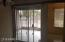 View from formal dining area to screened in enclosed patio
