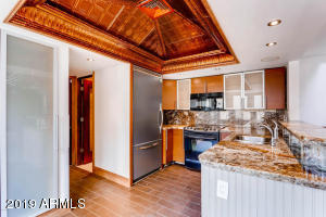 Lovely upgraded fully furnished unit for rent! This stunning townhome features copper, coffered ceiling, amazing granite counters, entertainers kitchen with granite backsplash, Viking refrigerator, microwave, Stacked washer & dryer + Pantry. Throughout the home there are tile floors, and fully upgraded Bathrooms with floor to ceiling granite and unbelievable finishes. Suspended copper ceiling in great room with ceiling fans for circulation, Murphy bed in 2nd bedroom. Amazing marble front fireplace in living room space. Cabinets in garage, with mirrored doors . All Copenhagen furniture in home. Community has a nice pool and grassy area.