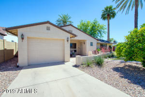 Located in one of the most desirable neighborhoods in Phoenix, this home is within short distance to La Grande Orange, Postino, North, Chelsea's Kitchen, and more! This property just underwent a refresh with all new paint, tile, carpet, appliances, and boasts a flexible floor plan including multiple living spaces, 4 bedrooms, and den. Large, irrigated lot with plenty of room for all! A lot of bang for the buck as a primary residence or a great investment for those looking to add to their portfolio.