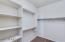 Ample room for your clothes in this master closet.