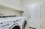 Indoor laundry with access to garage and added storage.