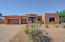 Front view, natural desert easy care landscape, large parking pad , wide side yard areas