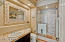 Powder Room with Shower adjacent to Bedroom 2 and Office