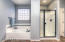 large tub, and separate shower area