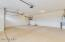 3 car garage has epoxy floor, dual garage door openers and extended (25 ft) double garage