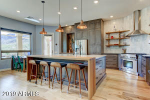 All kitchen cabinetry are custom through Stone Creek Furniture.