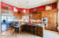 SPACIOUS KITCHEN WITH BREAKFAST BAR AND STAINLESS STEEL APPLIANCES