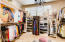 DESIGNER MASTER CLOSET CREATED WITH ATTENTION TO DETAILS AND ELEGANCE
