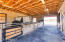 STATE OF THE ART BLOCK BARN WITH 4 STALLS CONVERTED IN 3 WITH COMMERCIAL FANS , SWAMP COOLERS AND LARGE BACK TURNOUTS. SURROUND SOUND MUSIC PLAYING ALL DAY LONG FOR YOUR HORSES.
