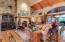 Dramatic Barrel & Wood Beam Ceiling In Living Room