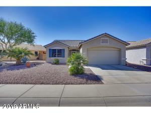 This lovely home is located on a more N/S facing lot in the guard gated 55+ community of Arizona Traditions. Low maintenance plants and trees grace this nice-size lot!