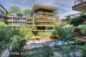 Welcome to this phenomenal Optima Camelview 2 Bedroom, 2 Bath, 1200SqFt Condo. Boasting incredible pool and lush landscaping views, this unit features an open kitchen floor plan with a large living room. You'll find beautiful shaker cabinetry in both the kitchen and bathrooms along with granite and marble countertops. Nice sized master bedroom features walk in closet. Simply a wonderful value for the price. All found within the luxurious optima camelview village with it's unbeatable location and state of the art architecture & design. Amenities include: a 24,000sqft fitness center with huge indoor pool and spa's, men's and women's locker rooms w/ steam room, showers and lockers - unbeatable on site concierge service - two outdoor zen pools w spas and bbq grills, putting green + much more!