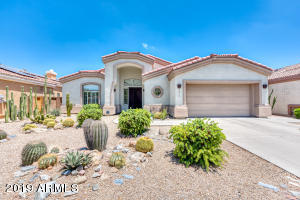 Welcome to this Beautiful Arcadia Lite Home! Built by the AWARD WINNING high-end Custom Home Builder Cullum Homes, this open 3B/2B floor plan features soaring ceilings, a wide foyer and an open living/dining room flooded with natural light. Enjoy your oversized master bedroom with a spacious dual vanity master bath and large walk-in closet. Entertain your guests in your beautiful kitchen with stainless steel appliances and granite countertops. Relax and enjoy your beautiful, low-maintenance, cactus garden retreat with a covered patio and tranquil sitting area. And don't forget to take a look at the oversized 2-car garage with built in workbench and storage. You don't want to miss this chance to live in the highly sought after Arcadia Lite neighborhood!