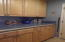 More cabinets that match Kitchen cabinets, oppoisite W/D
