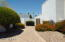 Wow! Great backyard! w/Green Grass but not too much. Lots of pavers & rock, + 3 Mesquite trees