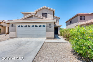 Welcome to this stunning turn-key home in the heart of San Tan Valley. Situated behind a desert common area that provides additional privacy in a quiet community. With all new flooring and fresh paint, this home is ready for your move in. As you enter the home, you're greeted by an open floor plan with a spacious living room and an eat-in kitchen with breakfast bar. In addition to four bedrooms, there is a large loft that makes for the perfect play room, family room, or home office. Additional features include a low maintenance backyard, covered patio, and two-car garage. You can't beat the convenient location near all of San Tan's shopping, dining, golf, and gyms. Make this home yours before it's gone!