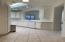 Easy to work in kitchen with newer hard surface counters overlooks the great room.